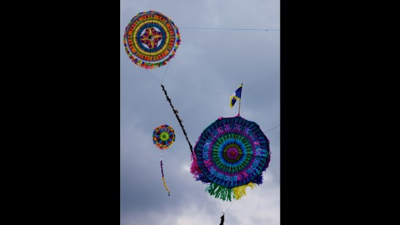 The Barriletes Gigantes festival is one of the region's main cultural events. On All Saints' Day, the people of Sacatepequez fly the giant kites, painted by hand, over the graves of their family members while they pray and deposit flowers.