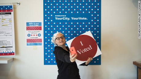 "MINNEAPOLIS, MN - SEPTEMBER 23: Minneapolis resident Robin Marty takes a selfie with an ""I Voted"" sign after voting early at the Northeast Early Voting Center on September 23, 2016 in Minneapolis, Minnesota. Minnesota residents can vote in the general election every day until Election Day on November 8. (Photo by Stephen Maturen/Getty Images)"