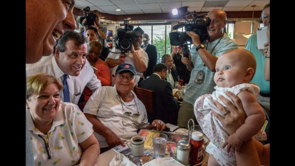 A baby looks at Maryland Gov. Larry Hogan at a diner in Annapolis, Maryland, on July 15, 2015. Hogan was there to endorse Republican presidential candidate Chris Christie, at left in the blue tie. Christie joined the race with strong national name recognition and a record in public office that spans more than a decade, having served as New Jersey