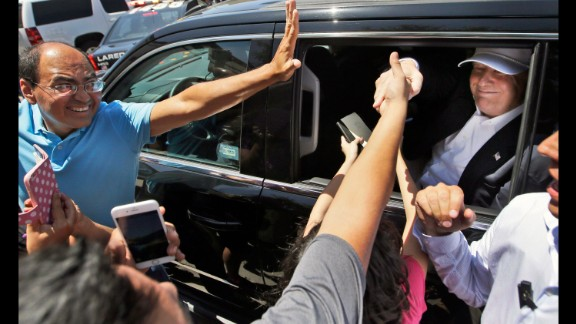 Supporters reach out to Trump as he leaves a stop in Laredo, Texas, on July 23, 2015. During a four-hour visit, Trump met with local officials and toured the border between the United States and Mexico. His visit was the culmination of more than a month of attention centered on Trump