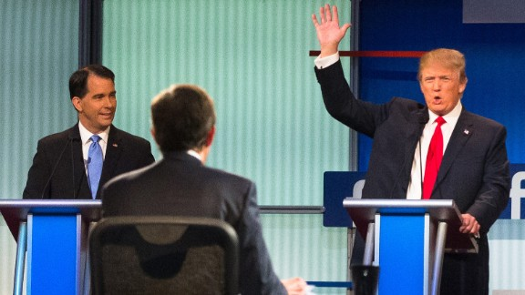Trump raises his hand during the first Republican debates of the campaign, which took place in Cleveland on August 6, 2015. Trump kicked off the event by refusing to rule out a third-party run and pledge his support to whoever becomes the Republican nominee. He was joined on stage by nine other candidates -- seven of the lower-polling candidates had a separate debate before the main event.