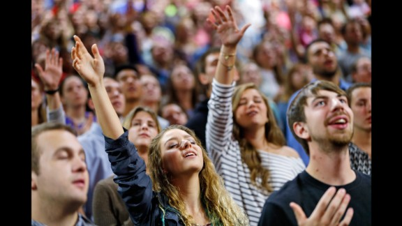 Liberty University students pray before a Sanders speech in Lynchburg, Virginia, on September 14, 2015. Sanders, who was popular with many young voters during the Democratic primaries, staunchly defended abortion rights and same-sex marriage during his visit to the largest Christian college in the world.
