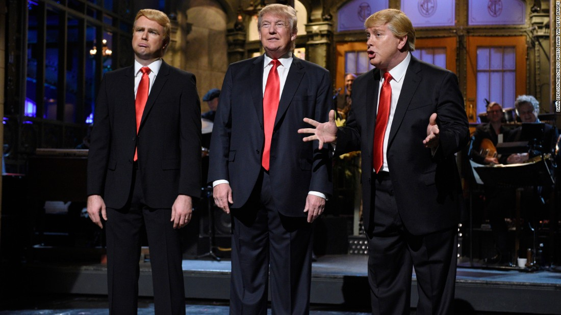 "Trump is flanked by impersonators Taran Killam, left, and Darrell Hammond during his ""Saturday Night Live"" monologue on November 7, 2015."