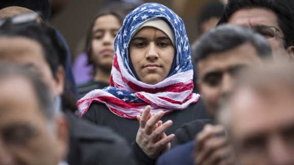 Hidayah Martinez Jaka wears an American flag hijab as Democratic presidential candidate Martin O