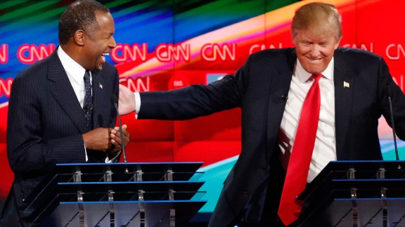 Trump shares a laugh with fellow candidate Ben Carson during the Las Vegas debate.
