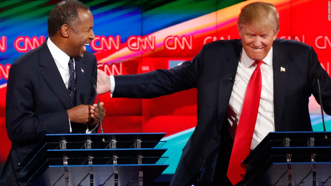 "Trump shares a laugh with fellow candidate Ben Carson during <a href=""http://www.cnn.com/2015/12/15/politics/gallery/gop-debates-las-vegas/index.html"" target=""_blank"">the Las Vegas debate.</a>"