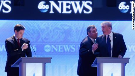 MANCHESTER, NH - FEBRUARY 06:  Republican presidential candidates New Jersey Governor Chris Christie (2nd R) and Donald Trump visit as Sen. Marco Rubio (R-FL) (L) stands close by during a commercial break in the Republican presidential debate at St. Anselm College February 6, 2016 in Manchester, New Hampshire. Sponsored by ABC News and the Independent Journal Review, this is the final televised debate before voters go to the polls for the New Hampshire primary on February 9.  (Photo by Joe Raedle/Getty Images)