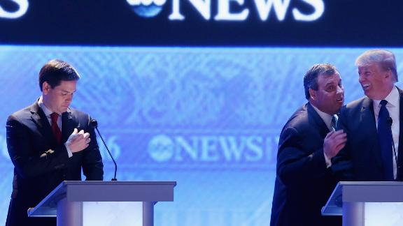 Trump and Christie talk to each other during a commercial break at the Republican debate in Manchester, New Hampshire, on February 6, 2016. At left is U.S. Sen. Marco Rubio. Trump won the New Hampshire primary on February 9 -- his first victory on the way to the nomination.