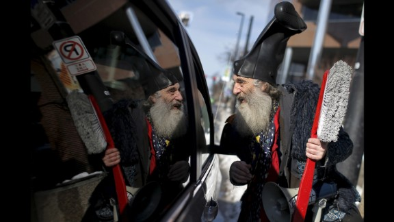 A performance artist named Vermin Supreme -- who officially registered as a presidential candidate -- talks to a motorist as he campaigns in Manchester, New Hampshire, on February 6, 2016.