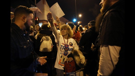 Trump supporter Birgitt Peterson argues with protesters outside a canceled Trump rally in Chicago on March 11, 2016. Peterson told the Chicago Tribune that she responded with a Nazi-style salute after anti-Trump protesters called her a Nazi. Trump