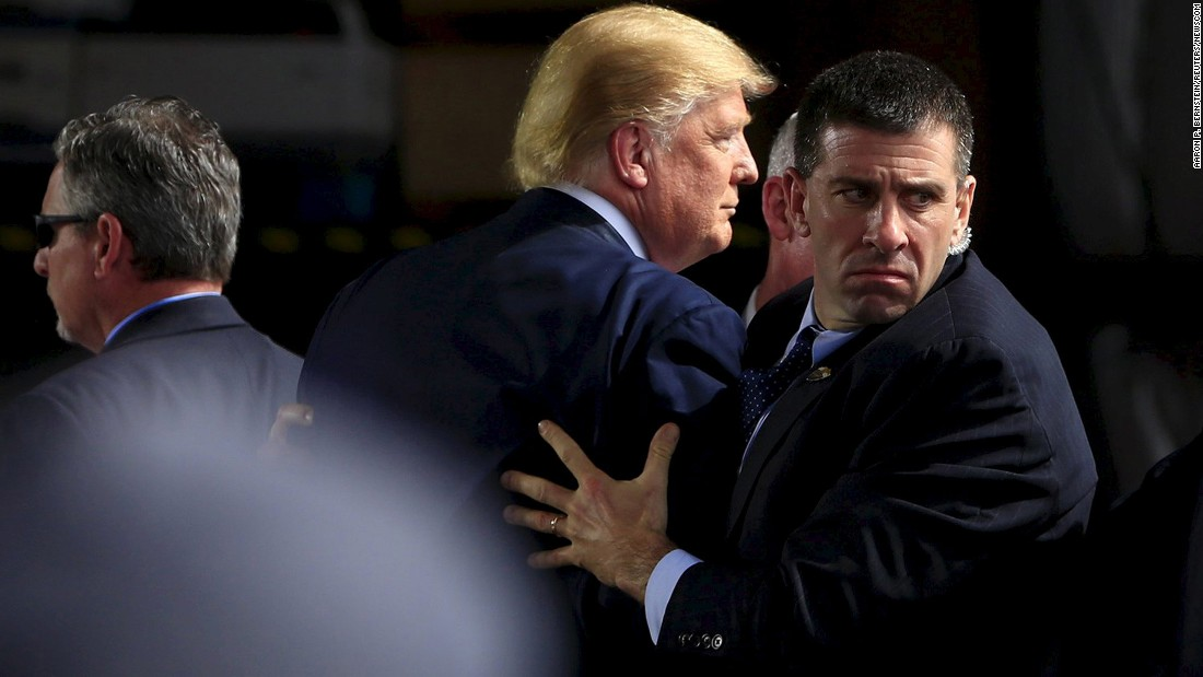 "Secret Service agents surround Trump as he speaks at Dayton International Airport in Dayton, Ohio, on March 12, 2016. A man <a href=""http://www.cnn.com/2016/03/13/politics/thomas-dimassimo-donald-trump-protester-interview/"" target=""_blank"">had tried to rush the stage.</a>"
