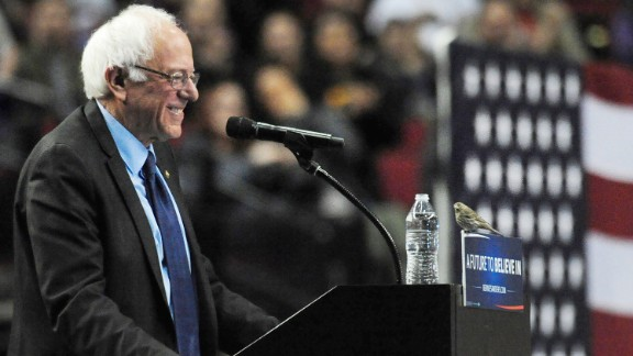 Sanders smiles at a bird after it landed on his podium in Portland, Oregon, on March 25, 2016.