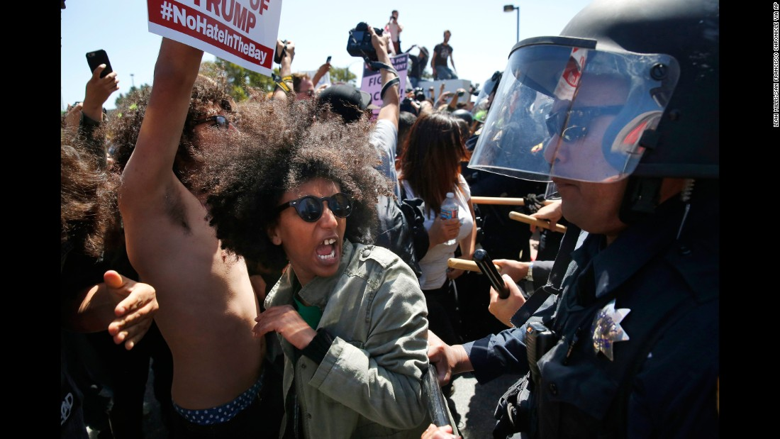 "Protester Biseat Yawkal yells as she is pushed by police outside of the California Republican Convention on April 29, 2016. Trump protesters -- some of whom wore bandanas over their faces and carried Mexican flags -- <a href=""http://www.cnn.com/2016/04/29/politics/donald-trump-protests-republican-convention-california/"" target=""_blank"">blocked off the road </a>in front of the Hyatt Regency, forcing Trump's motorcade to pull over along a concrete median outside the hotel's back entrance. Trump and his entourage got out and walked into the building."