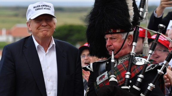 A man plays the bagpipes next to Trump after the candidate arrived at his Turnberry golf resort in Scotland on June 24, 2016. Trump became the GOP