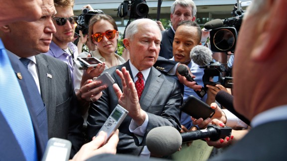 U.S. Sen. Jeff Sessions, center, talks with reporters after Trump met with the Senate Republican Conference on July 7, 2016. Trump had come to Capitol Hill with the hopes of unifying the party. Sessions, one of Trump
