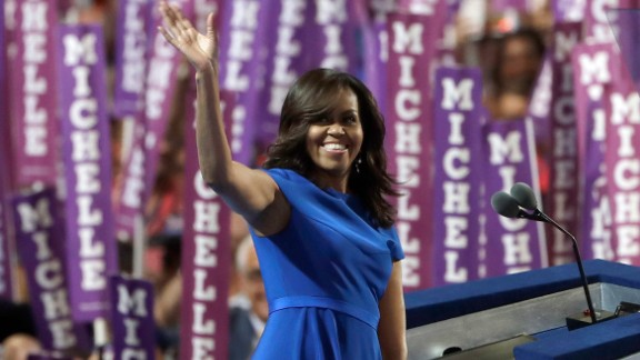 First lady Michelle Obama waves to delegates in Philadelphia as she speaks on the first day of the Democratic National Convention on July 25, 2016. Obama cast the presidential race as one between a positive role model for children and a damaging one.
