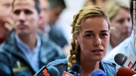 "Lilian Tintori, wife of prominent jailed opposition leader Leopoldo Lopez, speaks during a press conference in Caracas on November 2, 2016. A top Venezuelan opposition leader accused President Nicolas Maduro on Wednesday of trying to divide his enemies to undermine talks on defusing the country's political crisis. Jesus Torrealba, secretary general of the main opposition coalition, the Democratic Unity Roundtable (MUD), made the comments after Maduro called one coalition member, the hardline Popular Will party, a ""terrorist group."" / AFP / Ronaldo SCHEMIDT        (Photo credit should read RONALDO SCHEMIDT/AFP/Getty Images)"
