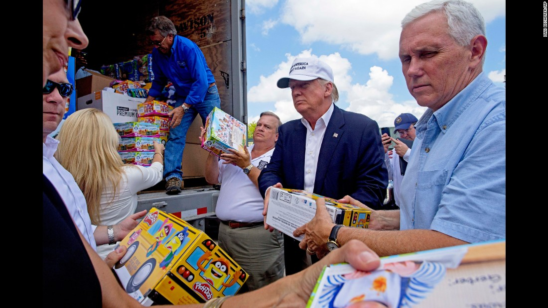 "Trump and Pence help unload supplies for flood victims during a visit to Gonzales, Louisiana, on August 19, 2016. The two were in the state following <a href=""http://www.cnn.com/2016/08/21/politics/louisiana-governor-donald-trump-visit-helpful/index.html"" target=""_blank"">massive flooding</a> in and around Baton Rouge."