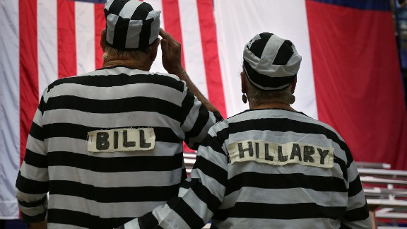 Trump supporters wear prison costumes with the Clintons
