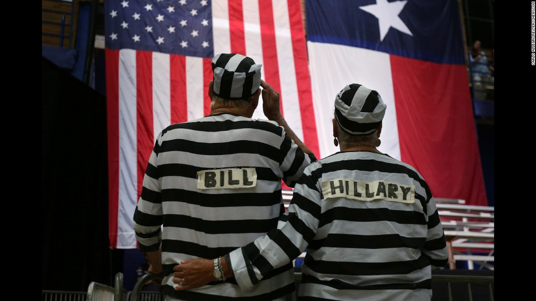 Trump supporters wear prison costumes with the Clintons' names on them at a campaign rally in Austin, Texas, on August 23, 2016.