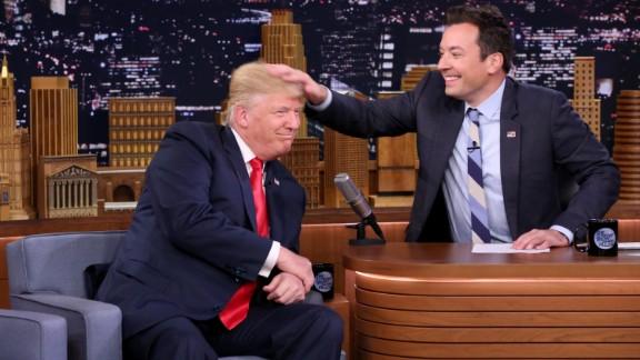 Talk-show host Jimmy Fallon musses Trump