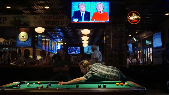 The first debate between Trump and Clinton is seen on television at a bar in San Diego on September 26, 2016.