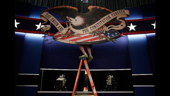 Workers prepare the stage for the second presidential debate, which took place in St. Louis on October 7, 2016.