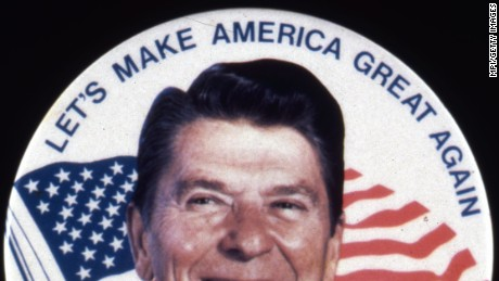 Ronald Wilson Reagan, the 40th president of the United States. A former actor and president of the Screen Actors Guild, he was elected governor of California in 1966 and US president in 1981. He is standing in front of a sign reading 'Let's Make America Great Again', during his electoral campaign.