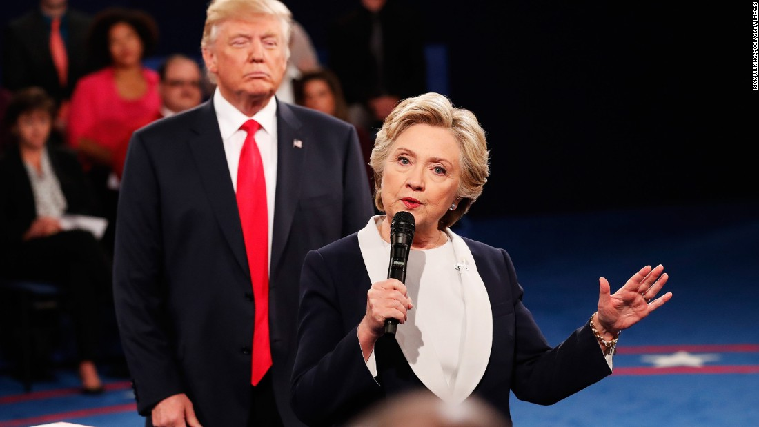 "Trump <a href=""http://www.cnn.com/2016/10/09/politics/donald-trump-looming-hillary-clinton-presidential-debate/"" target=""_blank"">looms behind Clinton</a> at the second debate, which was a town-hall format with questions from undecided voters."