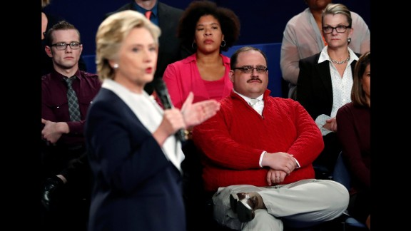 Undecided voter Ken Bone, in the red sweater, listens to Clinton during the second debate. Bone became a viral sensation after asking his question about the two candidates