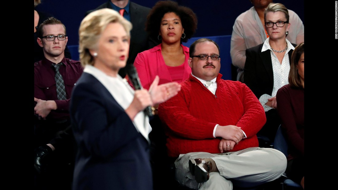 "Undecided voter Ken Bone, in the red sweater, listens to Clinton during the second debate. Bone <a href=""http://www.cnn.com/2016/10/10/politics/ken-bone-reveals-new-details-from-debate/index.html"" target=""_blank"">became a viral sensation</a> after asking his question about the two candidates' energy policies."