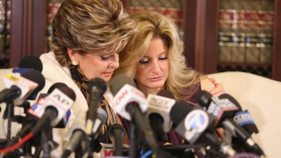 "Attorney Gloria Allred, left, holds a news conference with Summer Zervos, a former contestant on ""The Apprentice"" who has accused Donald Trump of grabbing her breast and kissing her aggressively in 2007.  The presidential candidate disputed Zervos"