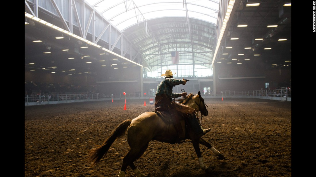 "Brian Bolton, from Creston, Iowa, participates in a mounted shooting competition at the Iowa State Fair on August 14, 2015. Photographer Landon Nordeman <a href=""http://www.cnn.com/2015/08/15/politics/gallery/iowa-state-fair-postcards/index.html"" target=""_blank"">visited the fair</a> in search of presidential candidates and interesting people."