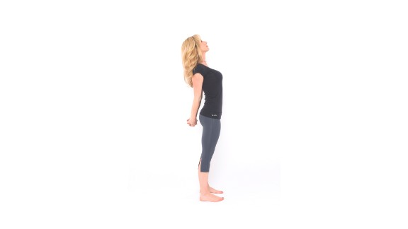 To release upper-body tension, from standing, clasp your hands behind your back and straighten your arms to the best of your ability as you look up, opening your chest, neck and shoulders. Hold the posture for a few breaths. Release and repeat.