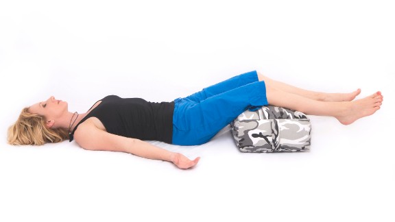 Lie down comfortably with a bolster or pillow under your legs and set a timer for a desired length of time; eight to 10 minutes is a good starting point. Close your eyes. Notice your breathing and the sense of release and comfort in your legs as they rest on the bolster. Remain committed to simply being in your body in your relaxed posture.