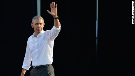 U.S. President Barack Obama waves to the audience after speaking at a campaign event for Democratic presidential nominee Hillary Clinton on the campus of the University of Chapel Hill on November 2, 2016 in Chapel Hill, North Carolina.