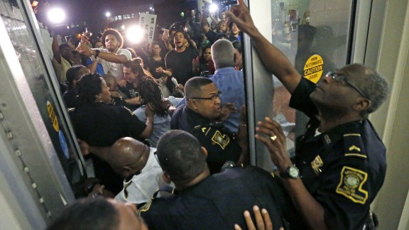 Police keep protesters from pushing through a door, before a debate for Louisiana candidates for the U.S. Senate, at Dillard University in New Orleans on Wednesday.