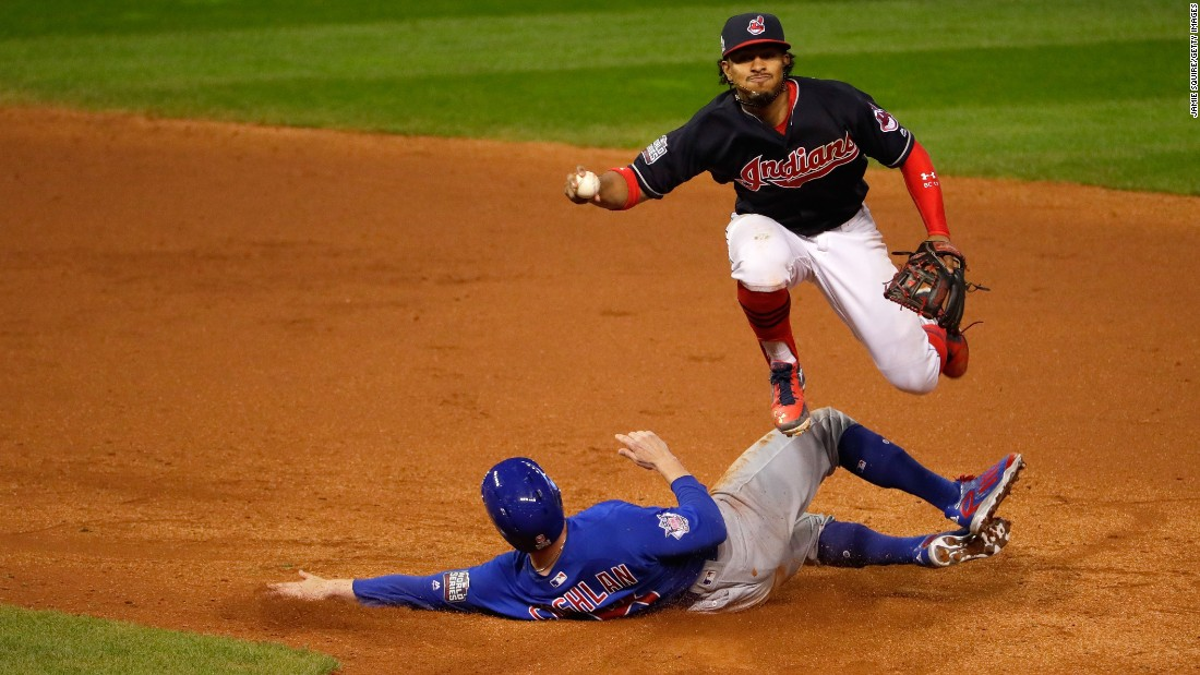 Francisco Lindor of the Indians jumps over Chris Coghlan of the Cubs in the ninth inning in Game 7.