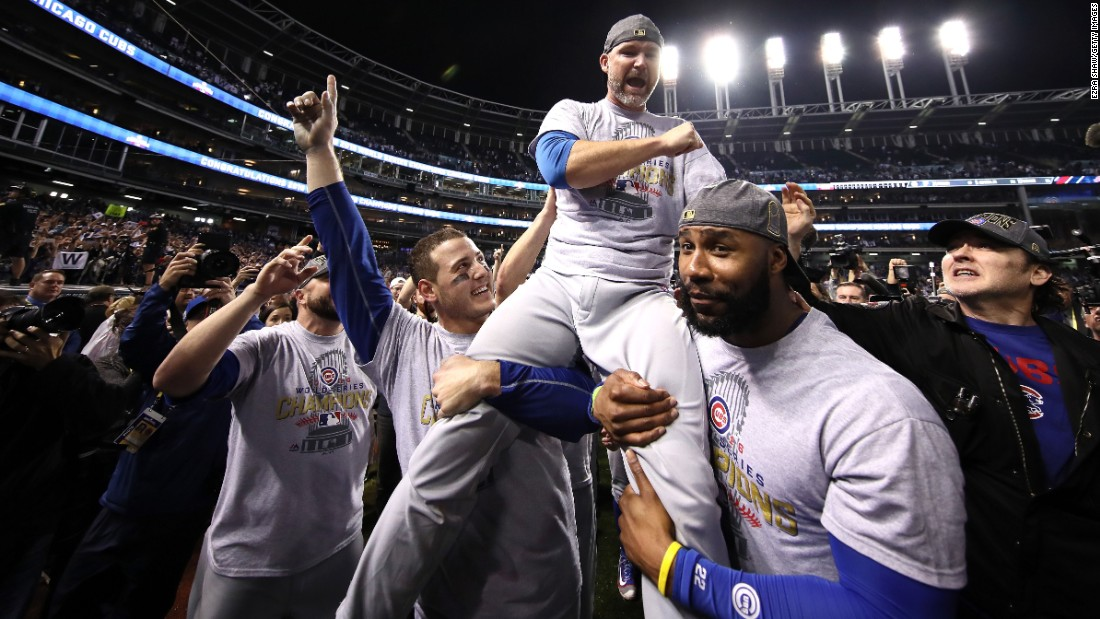 Anthony Rizzo, David Ross, and Jason Heyward of the Cubs celebrate with actor John Cusack (far right).
