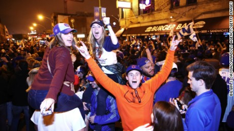 70eeb817204 Chicago Cubs fans celebrate in the streets of Cleveland on Wednesday
