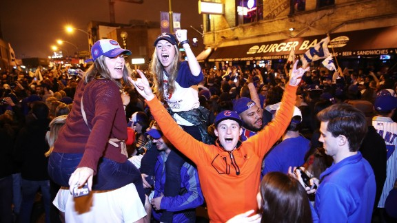 Chicago Cubs fans celebrate in the streets of Cleveland on Wednesday, November 2, after their team beat the Cleveland Indians to win their first World Series in 108 years.