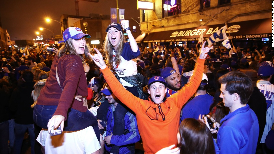 "Chicago Cubs fans celebrate in the streets of Cleveland on Wednesday, November 2, after their team beat the Cleveland Indians to win their first World Series in <a href=""http://www.cnn.com/2016/10/25/sport/gallery/last-cubs-world-series-win/index.html"" target=""_blank"">108 years.</a>"