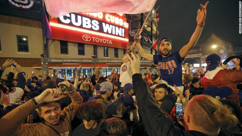 ad1d8e1fe07 Chicago Cubs fans celebrate in front of Wrigley Field in Chicago on  Wednesday