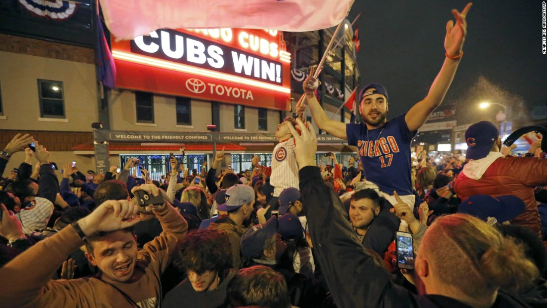 Cubs fans celebrate in Chicago. The team's long history of futility had many sports fans pulling for them. Even U.S. President Barack Obama, a fan of the rival Chicago White Sox, tweeted his congratulations.