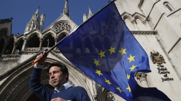 Phil Jones, 'People's Challenge' member waves an EU flag outside the Royal Courts of Justice.