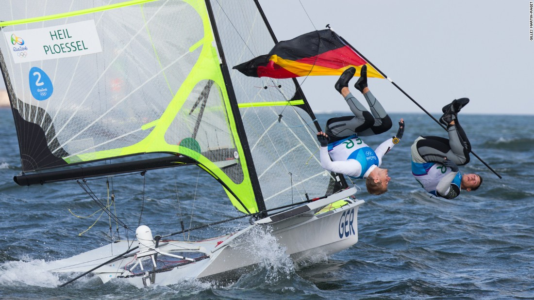 German duo Erik Heil and Thomas Ploessel perform a synchronized back flip after their eighth place in the final race in the Rio Olympics 49er class that earned them a bronze medal. Gilles Martin-Raget managed to snap the moment.