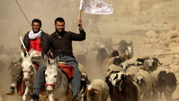 A man fleeing the village of Bazwaya carries a white flag as he arrives at a checkpoint on November 1.