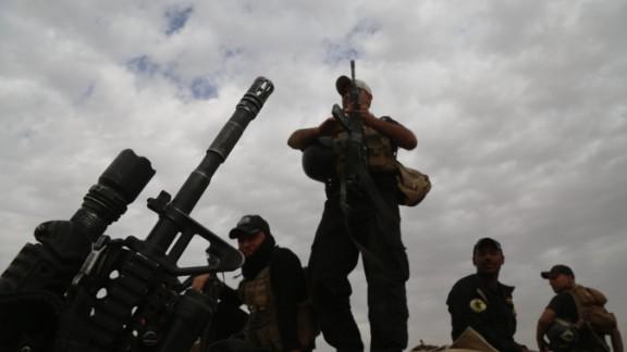 MOSUL, IRAQ - NOVEMBER 01: Iraqi army members guard at Mosul-Erbil Highway as the operation to retake Iraq