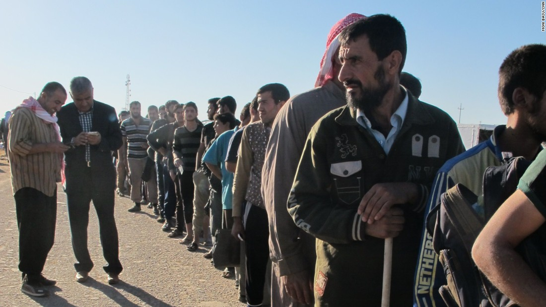 A long line snaked from the road to the entrance of the camp. Many of the Iraqis fleeing Mosul are poor. They said life under ISIS had been excruciatingly difficult with no electricity, schools or other services.