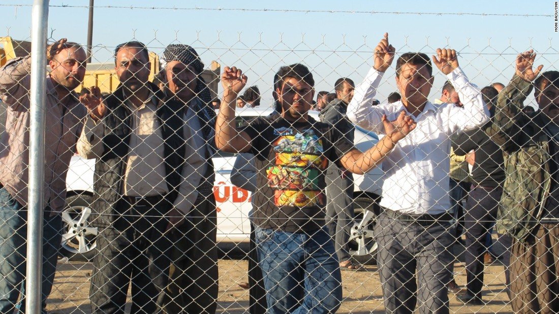 Fences separated the women, children and established residents of the camp from the men and boys who arrived Thursday.